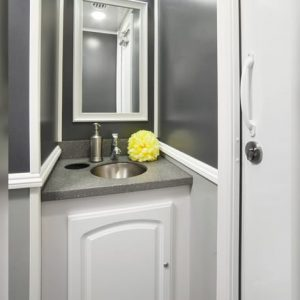 Interior restroom with countertops and mirror