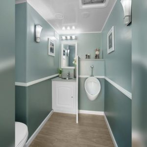 interior stall with urinal and sink