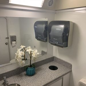 restroom sink and mirrot