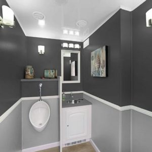 interior stall with sink and urinal