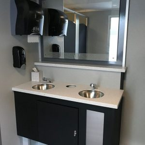 interior of restroom with dual sinks