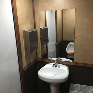 restroom trailer with sink and mirror