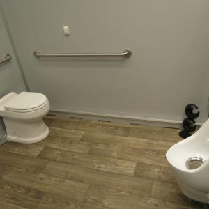 stall with toilet, grab bar and unrinal